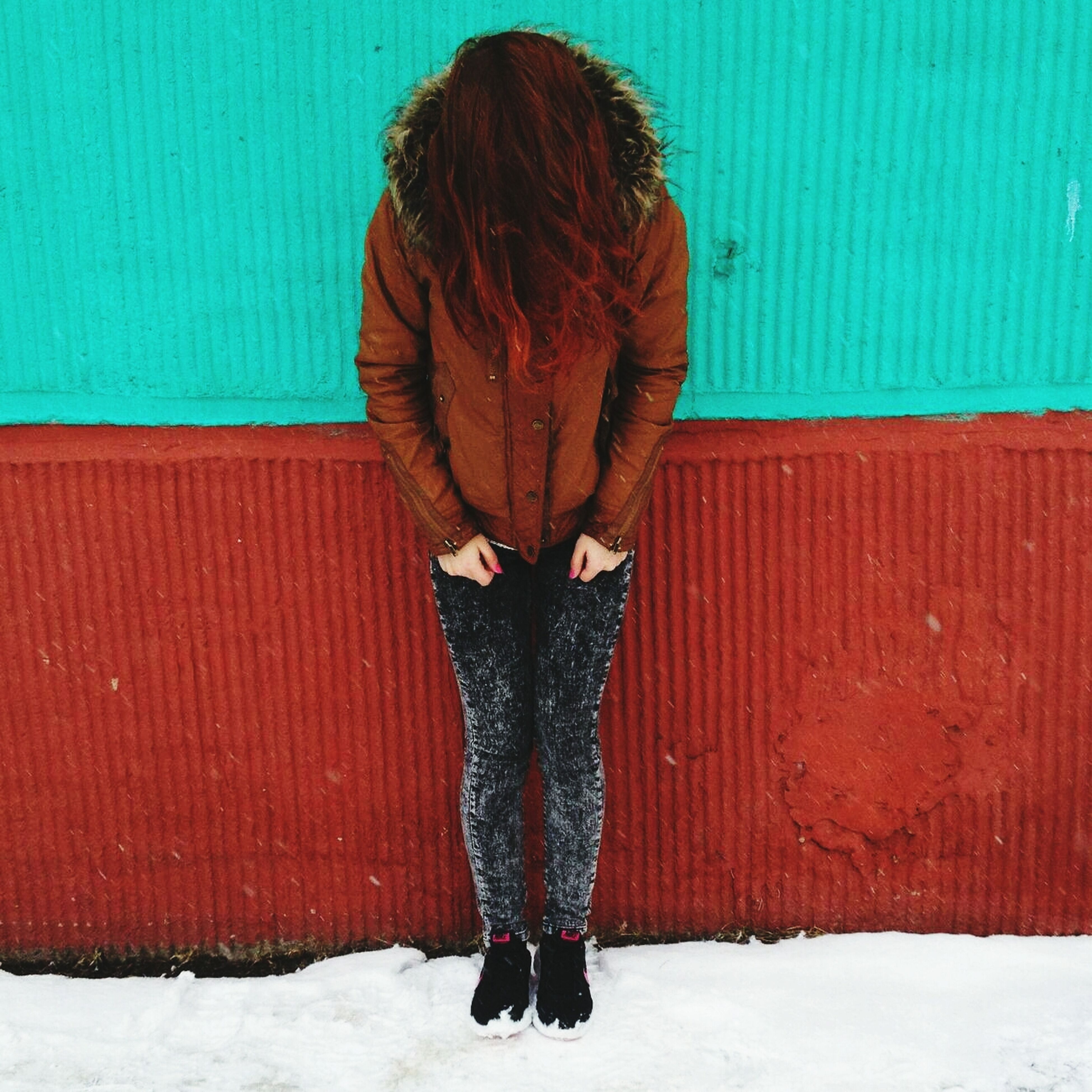 winter, snow, cold temperature, blue, season, standing, lifestyles, red, full length, rear view, warm clothing, covering, leisure activity, wall - building feature, built structure, house, architecture, casual clothing