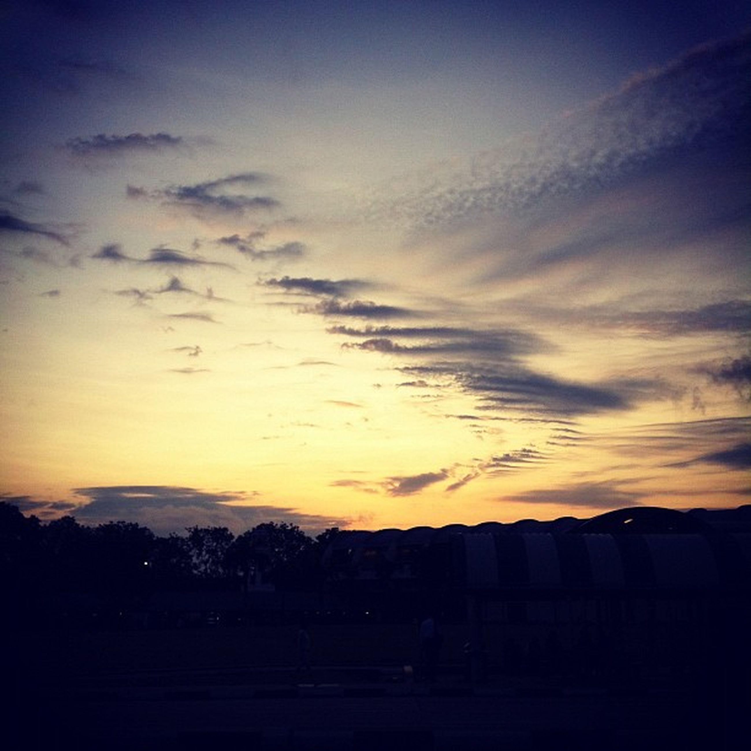 sunset, silhouette, sky, scenics, tranquil scene, tranquility, beauty in nature, landscape, cloud - sky, nature, orange color, idyllic, cloud, dramatic sky, dark, dusk, outdoors, field, no people, moody sky