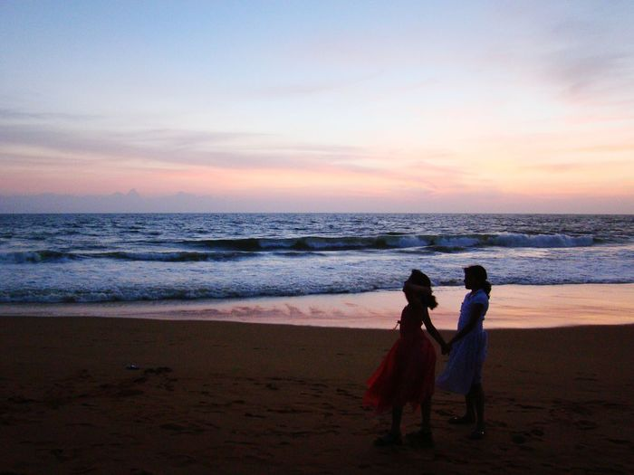 Sunset Beach Sea Sand Two People Sunset Horizon Over Water Vacations Togetherness Travel Destinations Beautiful Sunset Beautiful Sky Beach Photography Nature Beauty In Nature EyeEmNewHere Outdoors Sisters ❤