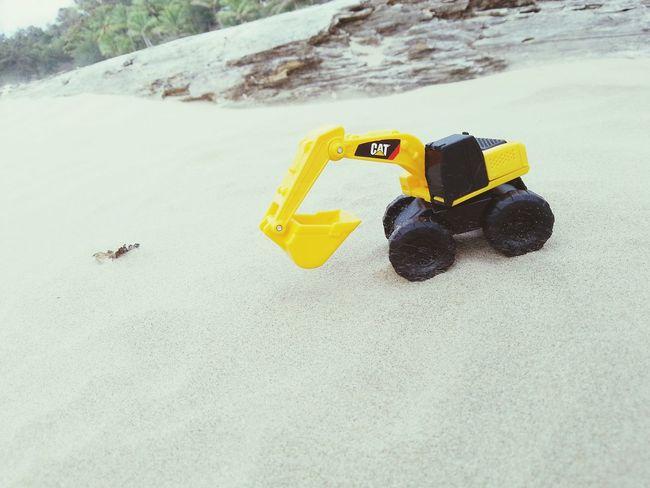 Small Toy Yellow Outdoors Beach Sandy Beach Sand Cat Kobelco No People Day Coastline Sea Trucker Cats Truck Toy