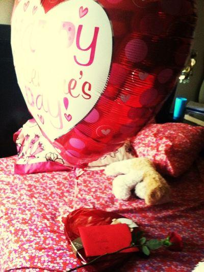 CHOCOLATE , a rose , a card , and a bigg ass balloon <3