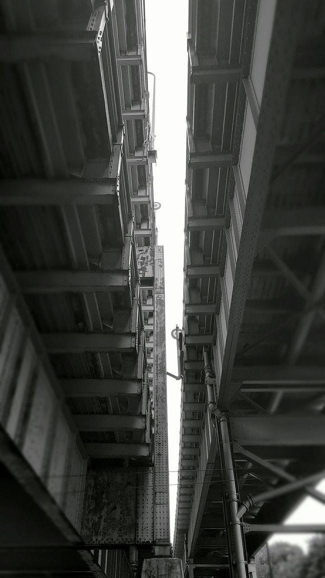 Divide. Underpassview Built Structure Bridge Bridge - Man Made Structure Low Angle View Cantilever Bridge Connection Separation Sky Day Tall - High The (Mystic) Tobin Bridge S6 EyeEm EyeEm Best Shots - Black + White Diminishing Perspective B&w Edit