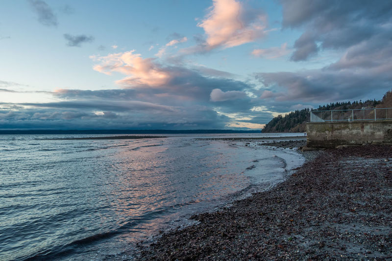 A view of the shoreline and sea wall in Des Moines, Washington in the evening. Des Moines Sea Wall Washington State Beach Beauty In Nature Cloud - Sky Day Evening Horizon Over Water Landscape Nature No People Outdoors Scenics Sea Sky Sunset Tranquil Scene Tranquility Water