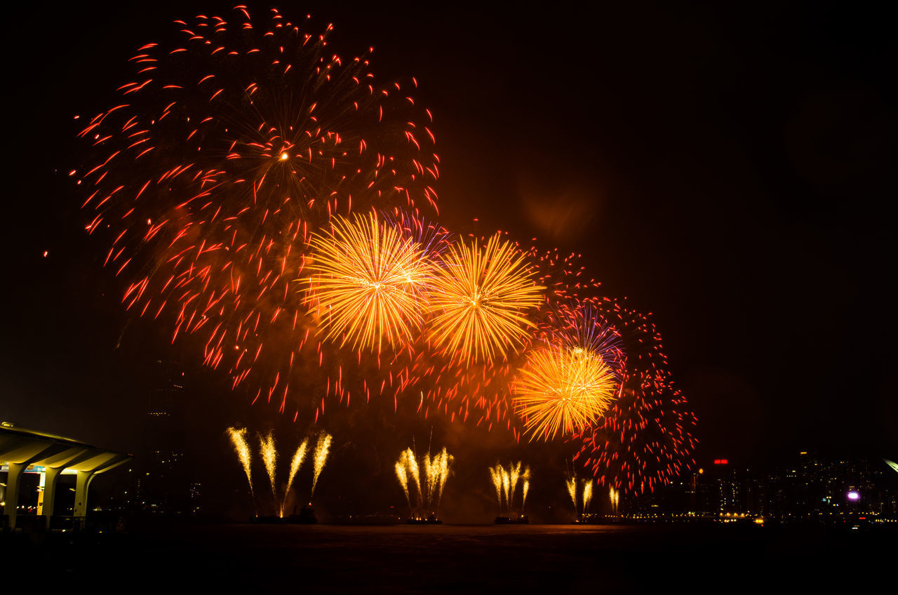 July 1st fireworks in Hong Kong Arts Culture And Entertainment Celebration Celebration Exploding Firework Firework Display Hong Kong Illuminated Illuminated Signs July 1st Low Angle View Multi Colored Night No People Outdoors Sky Victoria Harbour