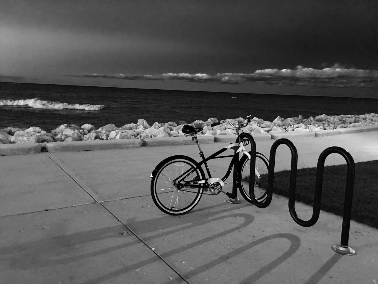 sea, bicycle, water, outdoors, sky, horizon over water, nature, beach, day, no people, transportation, bicycle rack