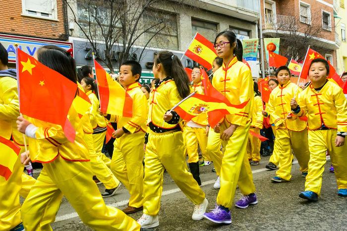 A line up of young children in yellow costume from the Chinese College in Madrid. The Chinese community in Madrid celebrated the Chinese New Year of the Monkey in the Usera district of Madrid, Spain. Boys Celebration Children Chinese Chinese Holiday Chinese New Year Chinese New Year 2016 Colours Editorial  Girls Happy Parade People Year Of The Monkey Yellow