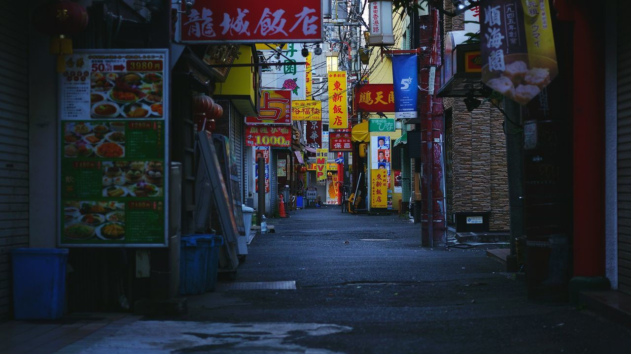 architecture, built structure, building exterior, the way forward, street, graffiti, city, road, wall - building feature, text, multi colored, diminishing perspective, building, residential building, store, residential structure, alley, outdoors, night, narrow