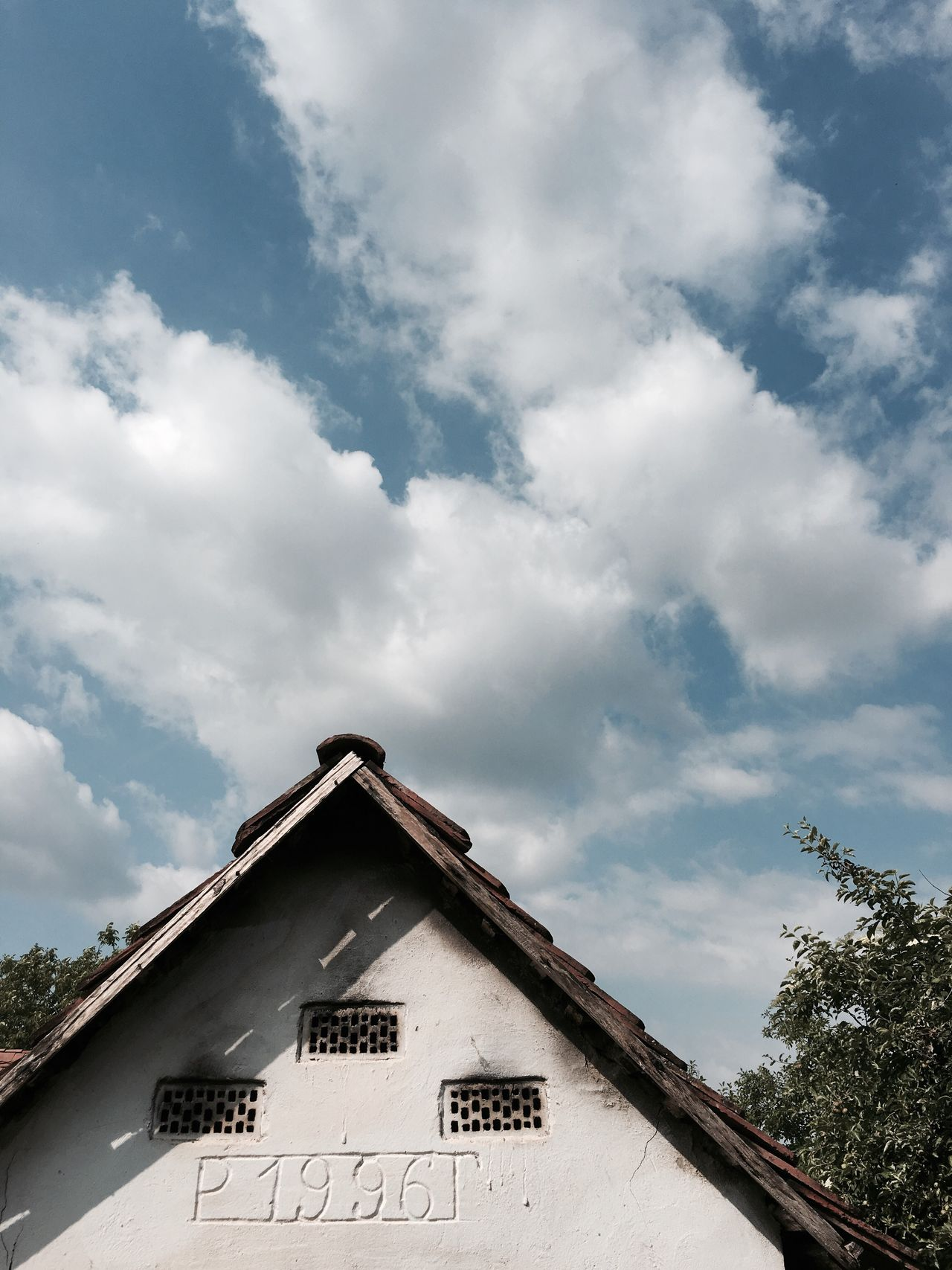 Sky Text Cloud - Sky Low Angle View Architecture Built Structure Day No People Building Exterior Outdoors Tree Nature