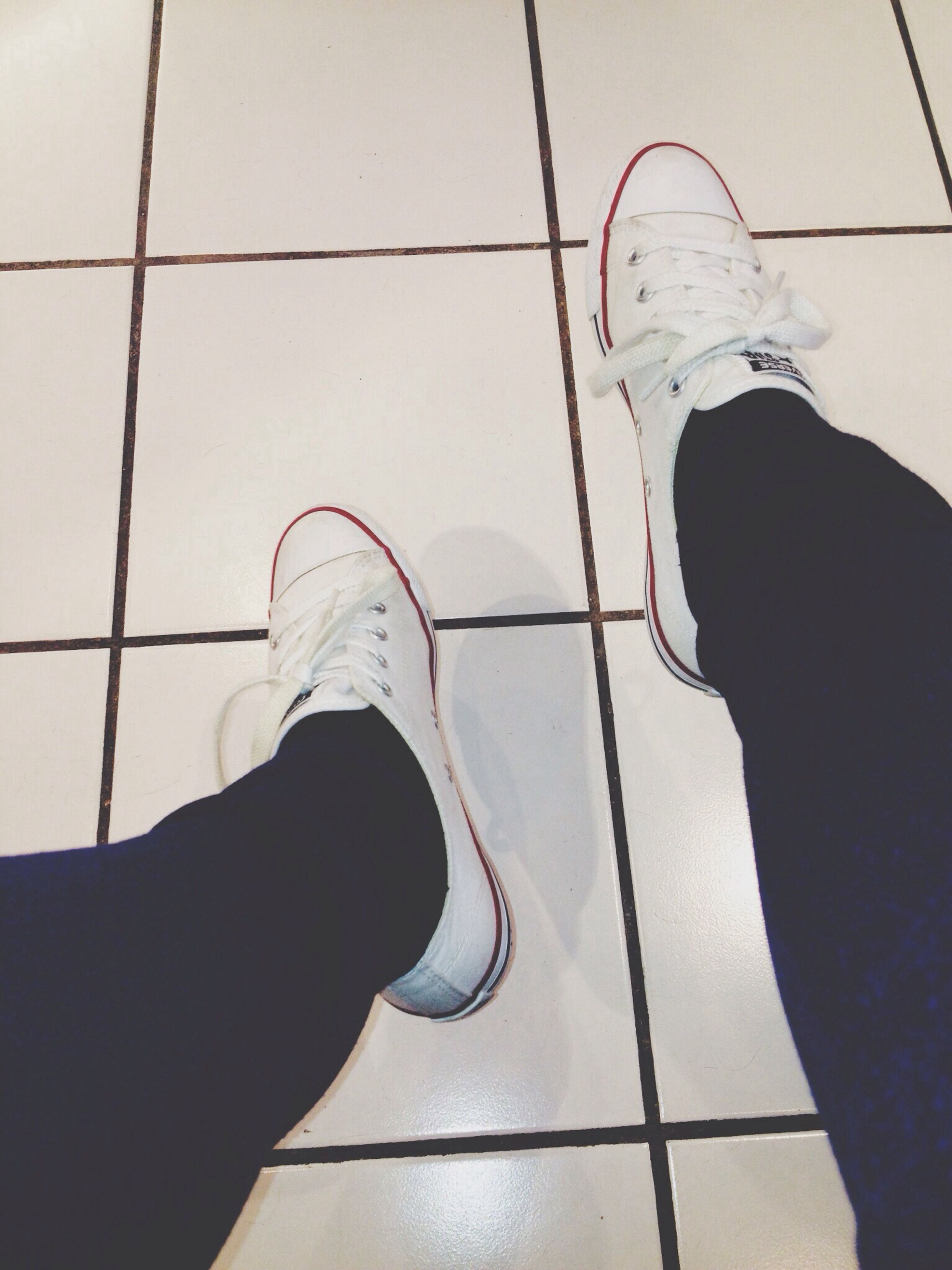 low section, person, shoe, personal perspective, lifestyles, standing, footwear, indoors, high angle view, tiled floor, men, leisure activity, human foot, unrecognizable person, jeans, part of