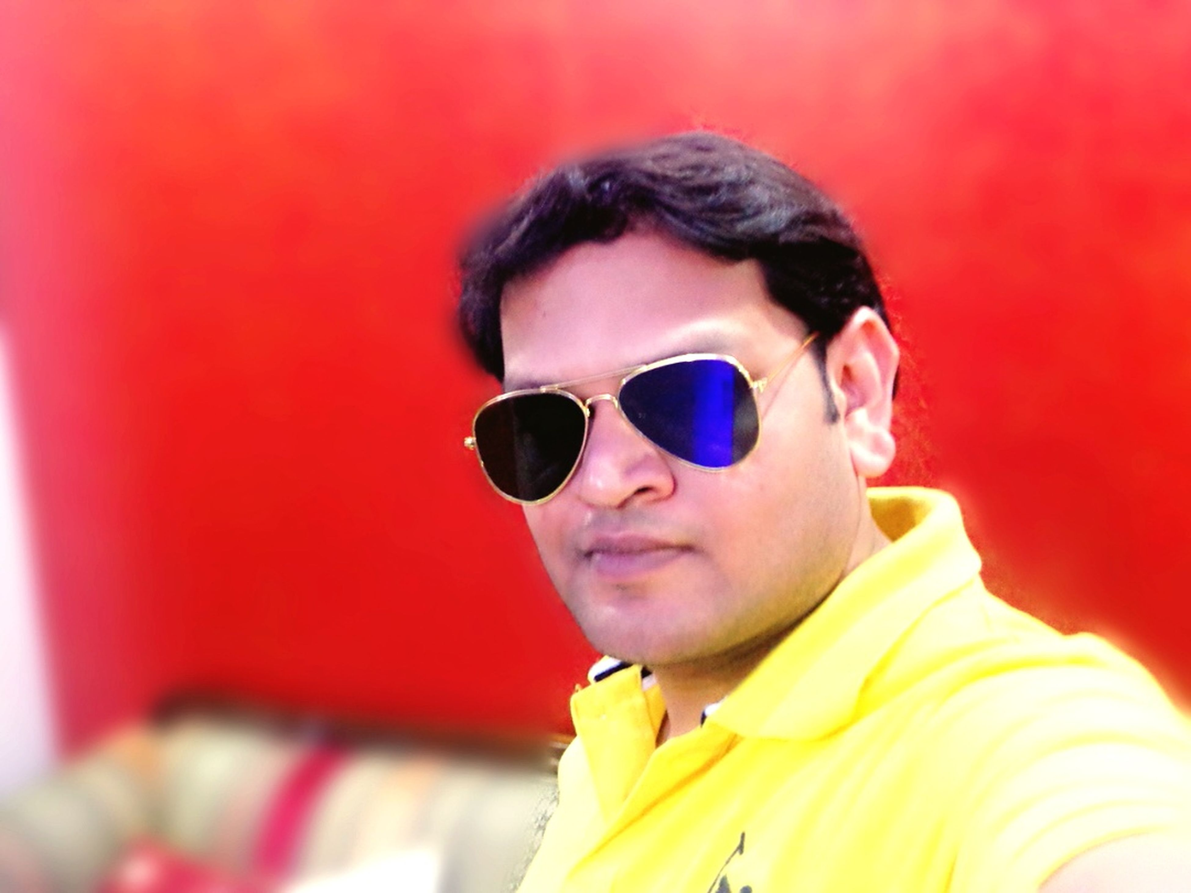 person, portrait, lifestyles, headshot, looking at camera, front view, leisure activity, childhood, young adult, casual clothing, smiling, elementary age, sunglasses, happiness, focus on foreground, boys, red