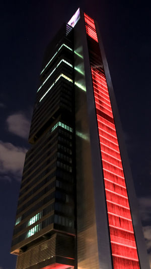 Architecture Building Exterior Built Structure Check This Out EyeEm Gallery Illuminated Low Angle View Madrid Towers Neon Night Nightphotography No People Outdoors Red Sky Skyscraper Torres De Madrid Tower Malephotographerofthemonth Welcome To Black