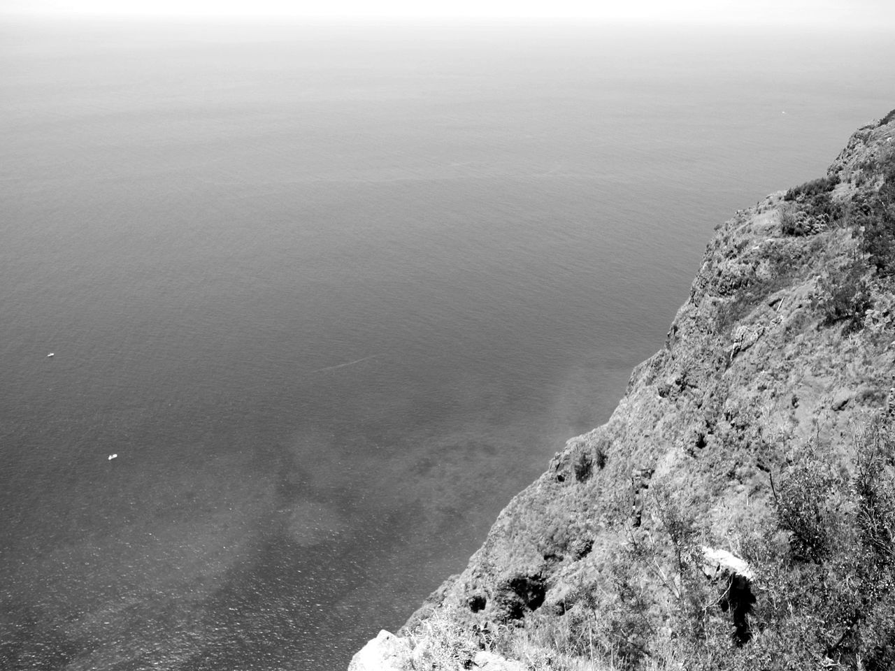 Beauty In Nature Cliff Day Nature No People Outdoors Rock - Object Scenics Sea Sky Tranquility Flying High Cliffs Sea And Sky View Aerial View Travel Destinations Rock And Sea Wide View Mountain Summer Rocks Rocks And Water Rocks In Water Black And White
