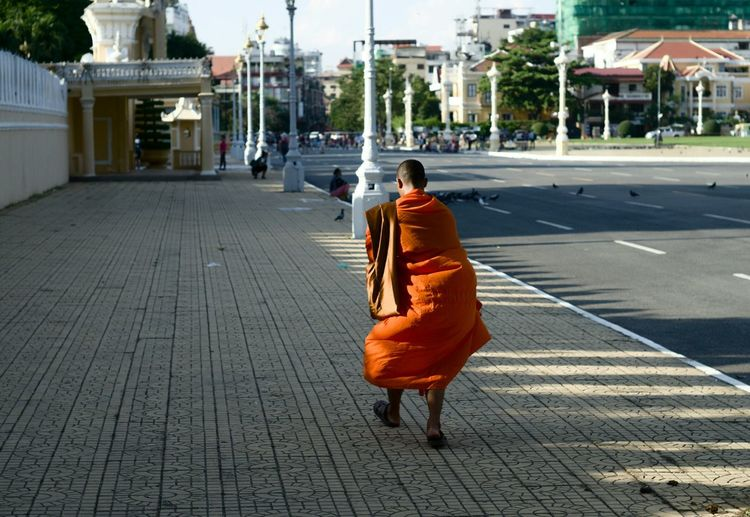 Showcase: November Lone monk wandering in the streets a few moments before sunset