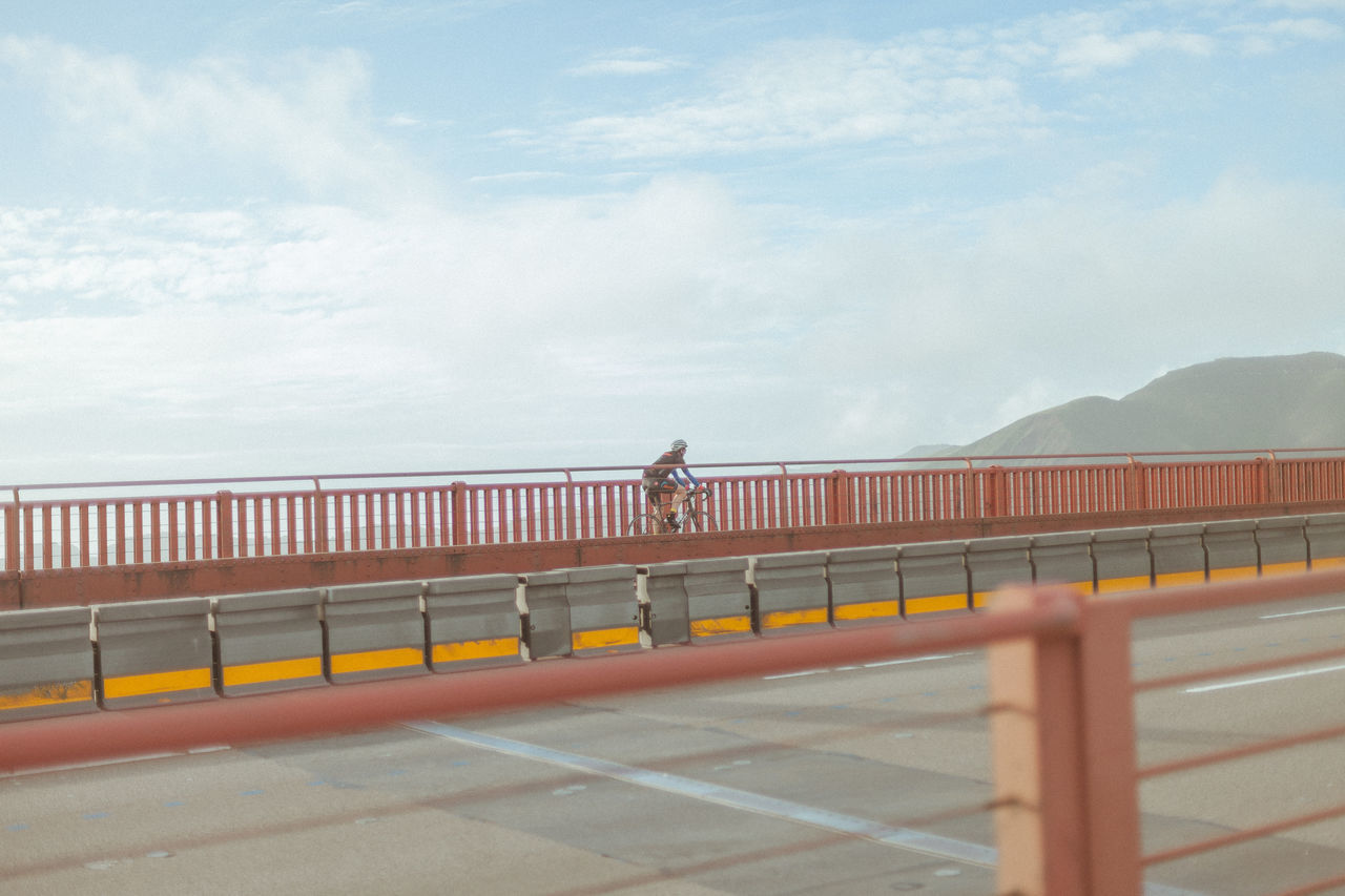 Cloud - Sky Day Golden Gate Bridge Men Mountain One Person Outdoors Railing Real People Road San Francisco Sky