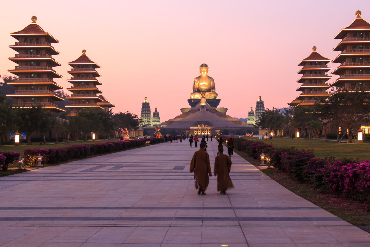 Kaohsiung, Taiwan - December 15, 2014: Sunset at Fo Guang Shan buddist temple of Kaohsiung, Taiwan with many tourists walking by. Architecture ASIA Asian  Asian Culture Buddha Buddha Statue Built Structure Capital Cities  City Dome Famous Place Fo Guang Shan Illuminated Kaohsiung Leisure Activity Lifestyles Religion Sky Summer Taiwan Temple - Building Tourism Tourist Tradition Travel Destinations