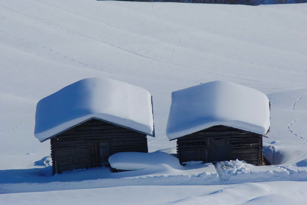 A Pair of Houses Houses On Mountain Snow Cold Temperature Sunshine And Snow Swizzerland Barns No People