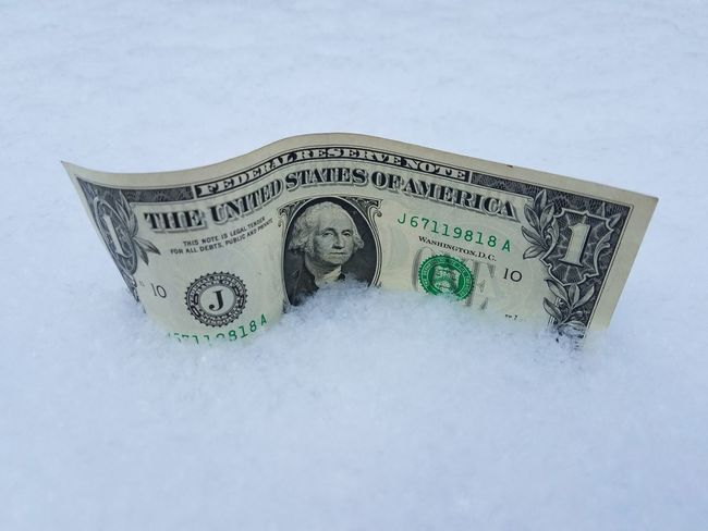 1 U.S Dollar bill half-buried in the snow U.s Dollar Bill Heating Bill Power Bill Energy Bill Affordable Paper Currency Finance Currency Wealth Stock Market And Exchange Loss Business