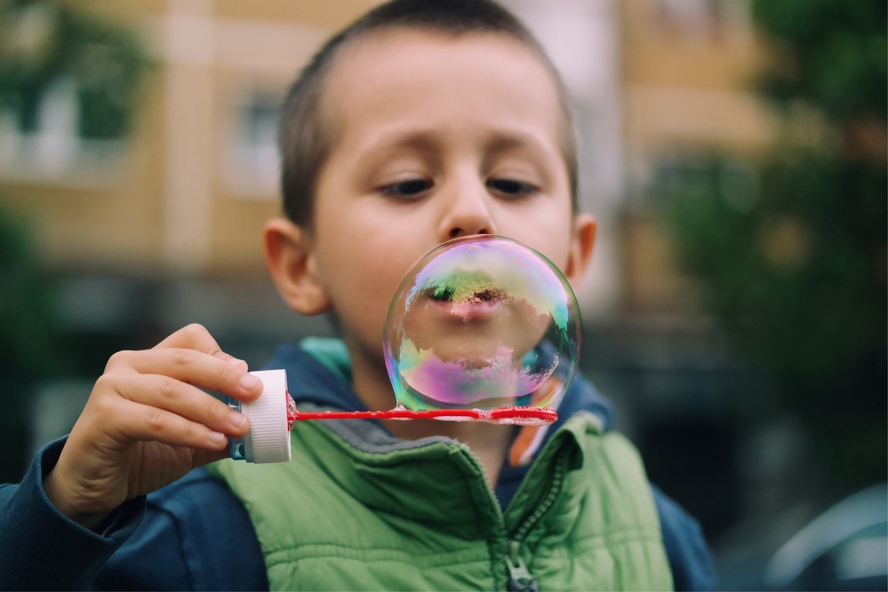 Colorful sphere... Bubble Wand Bubble Real People Childhood Front View Blowing Focus On Foreground One Person Holding Day Leisure Activity Fun Fragility Casual Clothing BYOPaper! Lifestyles Outdoors Architecture Playing The Great Outdoors - 2017 EyeEm Awards Made In Romania Details Of My Life VSCO Happiness Blowing Bubbles