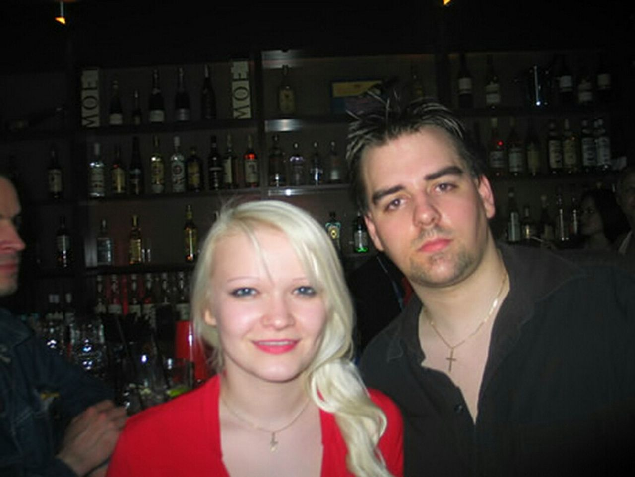 two people, alcohol, headshot, adults only, looking at camera, happy hour, blond hair, portrait, front view, indoors, young adult, casual clothing, people, bar - drink establishment, togetherness, young women, drink, happiness, adult, nightlife, men, smiling, well-dressed, human body part, night, friendship, close-up