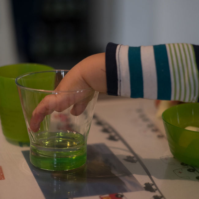 Frühkindliche Feinmotorik 2 Close Up Colorful Drinking Glass Finger Fingers Focus On Foreground Forearm Glasses Green Color Grip Gripping Hand Searching Selective Focus Striped Pattern