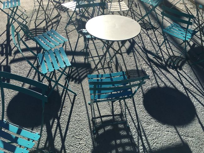 Architecture Bare Tree Blue Branch Building Exterior City Life Day Electric Light Lamp Post Lighting Equipment Low Angle View No People Outdoors Repetition Sky Wrought Iron Chairs Tables