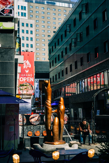 Myeongdong 2016: Man In Cool Afternoon Light Seoul South Korea MyeongDong Art Sculpture Man Cool Afternoon Light And Shadow Resting Sitting Waiting Travel The Street Photographer - 2016 EyeEm Awards Street Photography