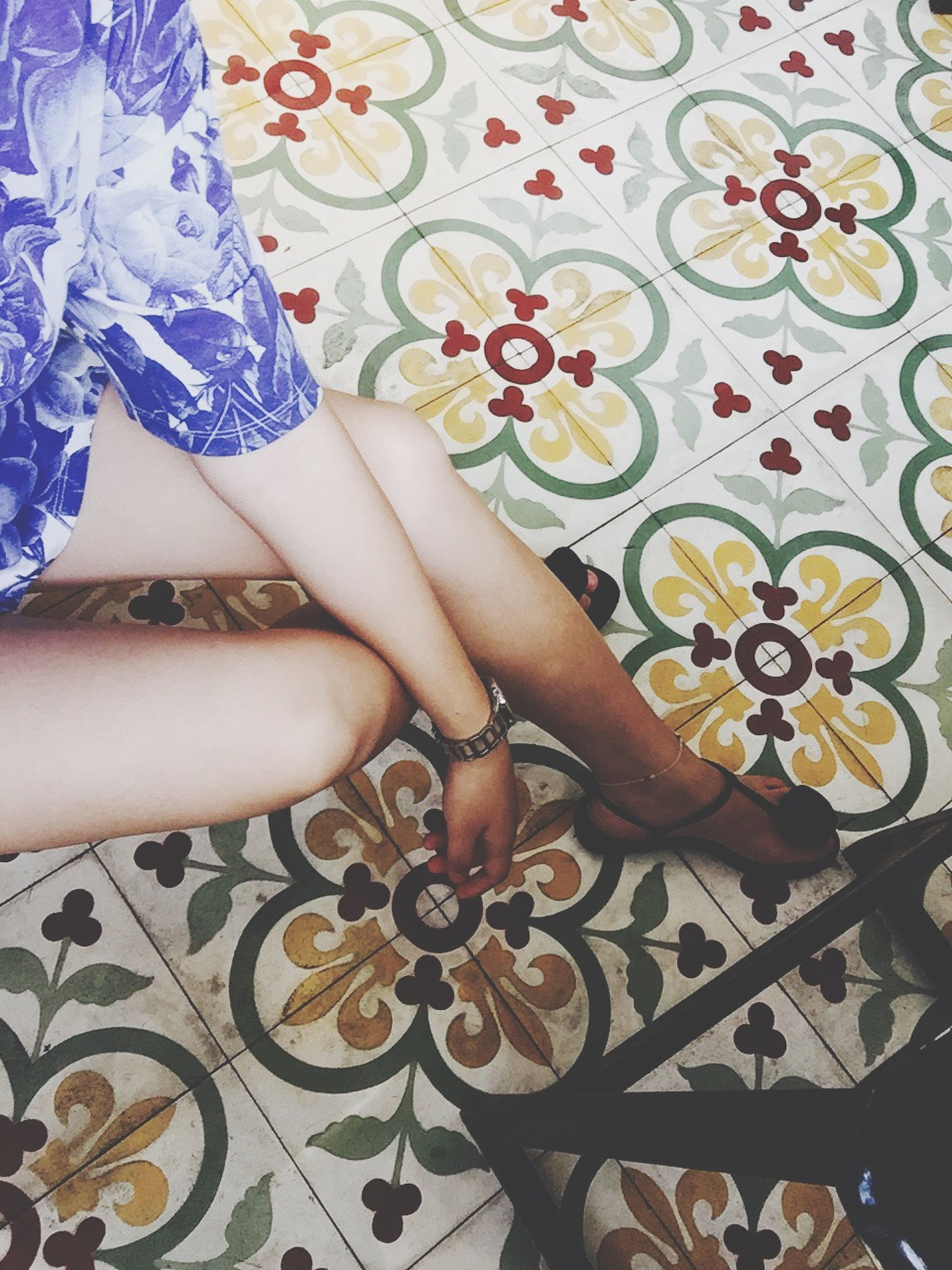 indoors, lifestyles, person, low section, floral pattern, leisure activity, sensuality, creativity, part of, art, young women, design, pattern, wall - building feature, fashion
