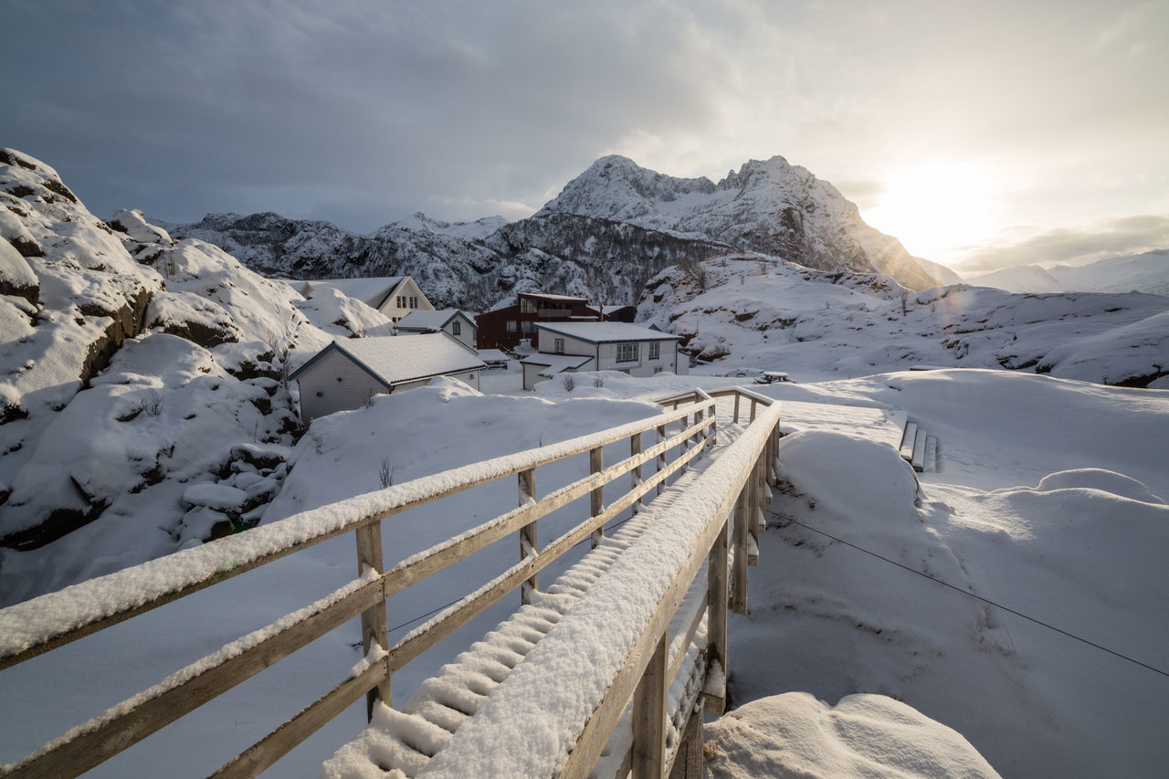 Beauty In Nature Bridge - Man Made Structure Cloud - Sky Cold Temperature Cottage Day Extreme Weather Landscape Mountain Mountain Range Nature No People Northern Norway Norway Outdoors Scenics Senja  Senja Island Sky Snow Snowcapped Mountain Sun Village White Color Winter