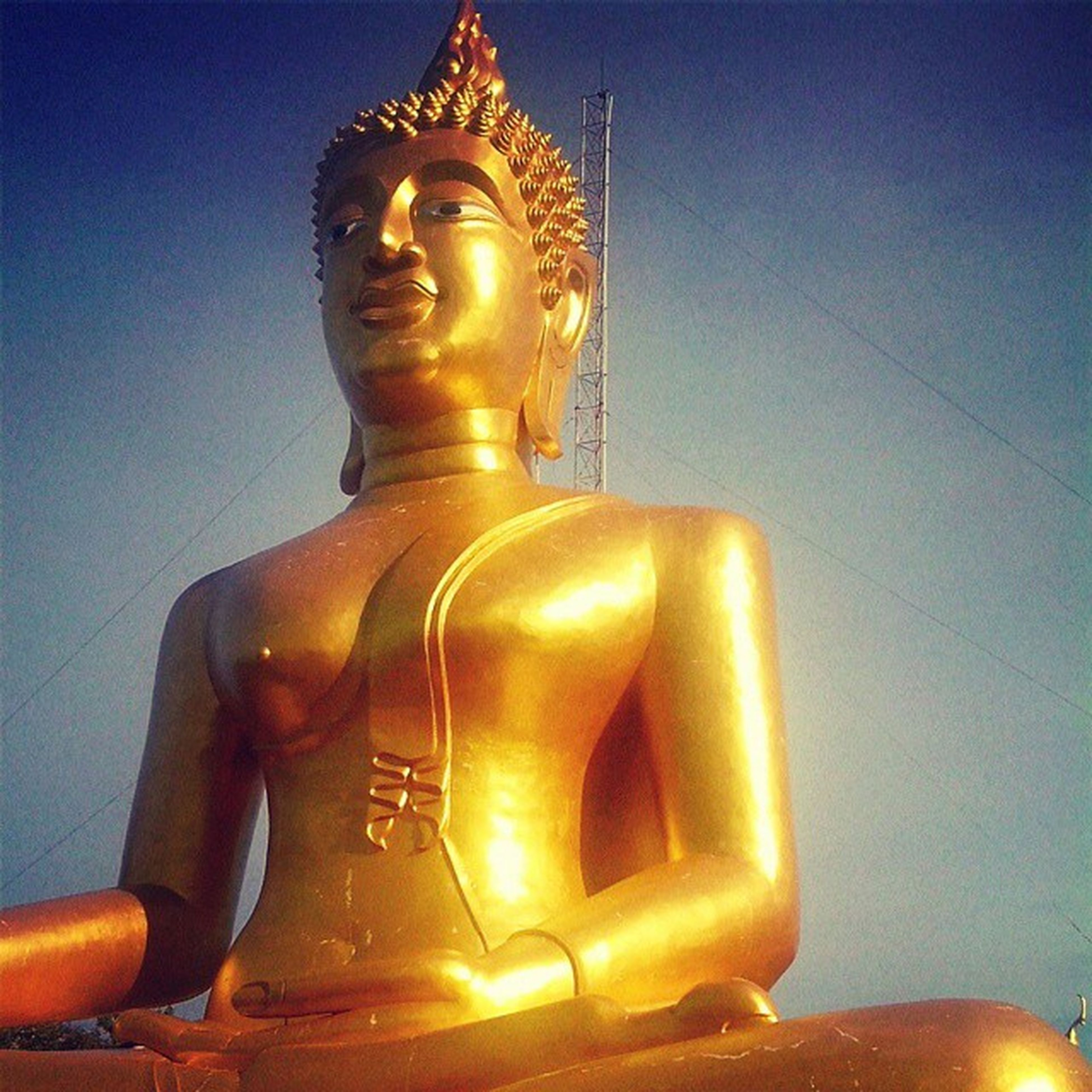 sculpture, statue, human representation, low angle view, art and craft, religion, art, creativity, spirituality, illuminated, place of worship, gold colored, buddha, carving - craft product, no people, sky