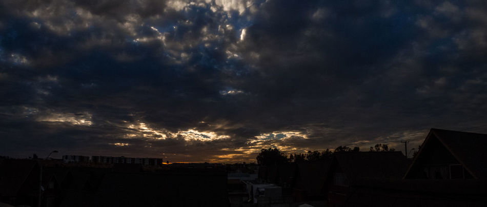I love cloudy sunsets. Camera: Canon PowerShotSX50 Afternoon Architecture Beauty In Nature Blue Building Exterior Built Structure City Cloud Cloud - Sky Day Dramatic Sky Light Nature No People Outdoors Silhouette Sky Storm Cloud Sunset Weather Yellow