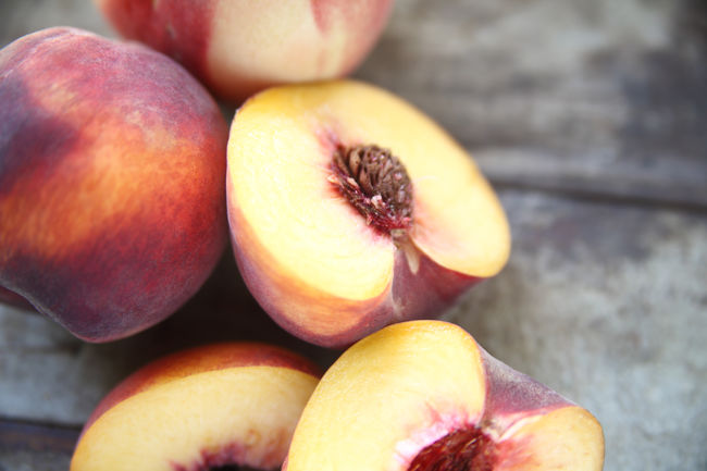 Close-up Colorful Food Fresh Fruit Gray Halves Healthy Eating Natural Light Nature No People Nobody Organic Outdoors Peach Pit Peaches Produce Red Seasonal Sweet Text Space Textures Whole Wood Surface Yellow