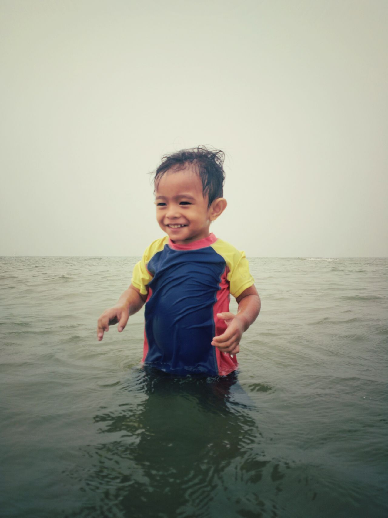 One Person Smiling Fun Childhood People Portrait Sea Full Length One Boy Only Beach Cute Holding Enjoyment Day Males  Happiness Water Motion Playing Boys Outdoors Holiday Vacation Fun Happy