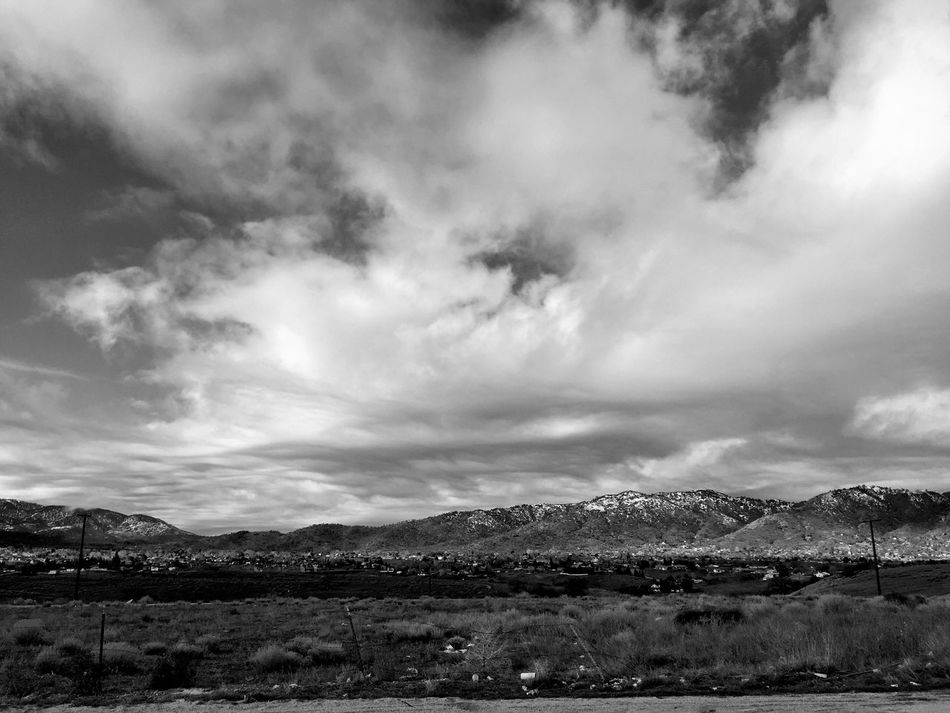 """""""Tehachapi"""" The small town of Tehachapi, California, USA sits at the feet of mountains and clouds. Clouds And Sky Clouds Cloudscape Mountains Winter Snow Blackandwhite Black And White Blackandwhite Photography Black And White Photography"""