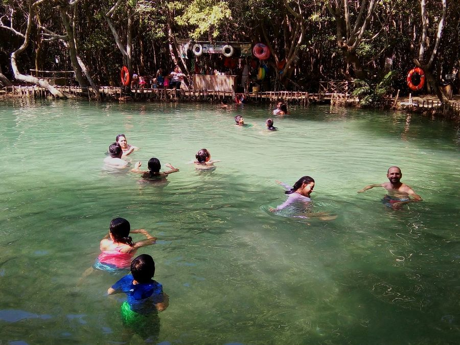 Water Leisure Activity Large Group Of People Vacations Lifestyles High Angle View River Person Nature Weekend Activities Joy Enjoyment Tourism Flowing Water Shadows & Lights Personal Perspective Mérida Yucatán Mexico Tranquility Relaxing Beauty In Nature Backgrounds Tranquil Scene