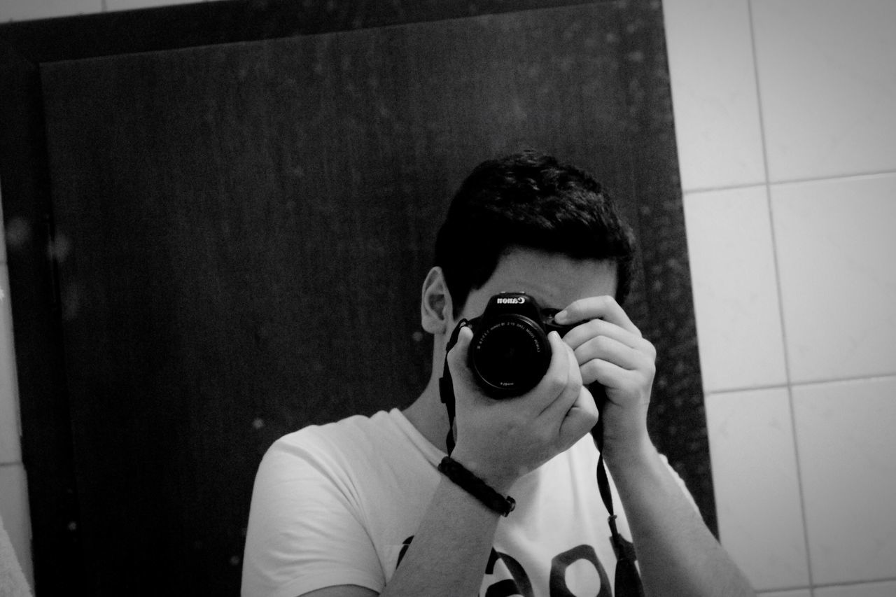 Photography Themes Real People Camera - Photographic Equipment Photographing One Person Leisure Activity Technology Headshot Digital Camera Indoors  Holding Photographer Camera Lifestyles Young Adult Day Digital Single-lens Reflex Camera Me :)  Sophisticated Black And White Monochrome BYOPaper!