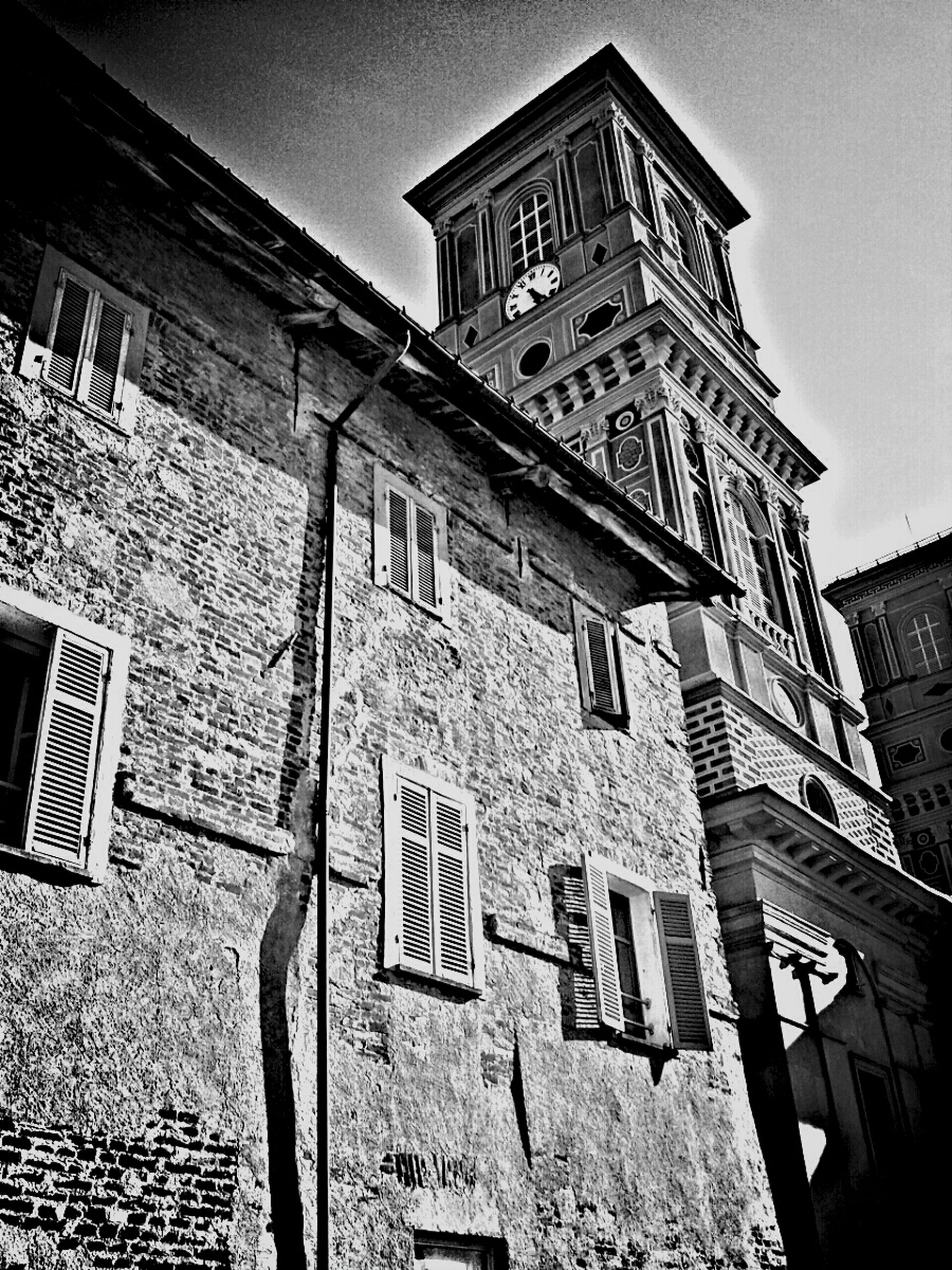 architecture, building exterior, built structure, low angle view, window, brick wall, clear sky, building, sky, day, outdoors, no people, text, city, facade, wall - building feature, sunlight, tower, old, religion
