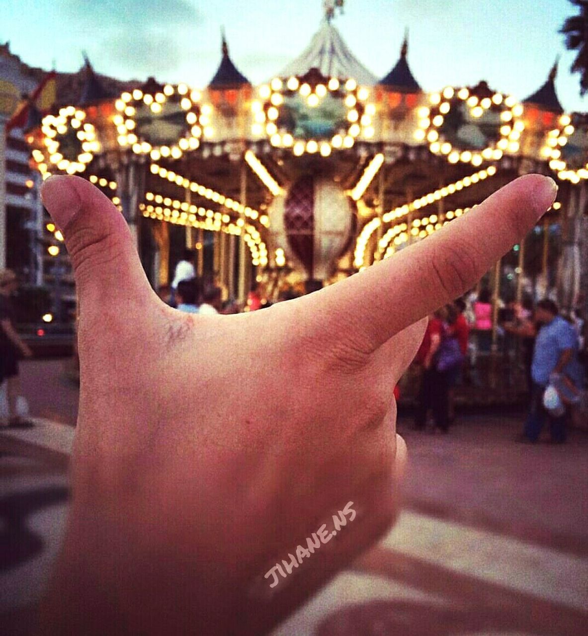 human hand, real people, human body part, human finger, focus on foreground, one person, personal perspective, outdoors, leisure activity, close-up, holding, lifestyles, men, illuminated, women, day, carousel, adult, people