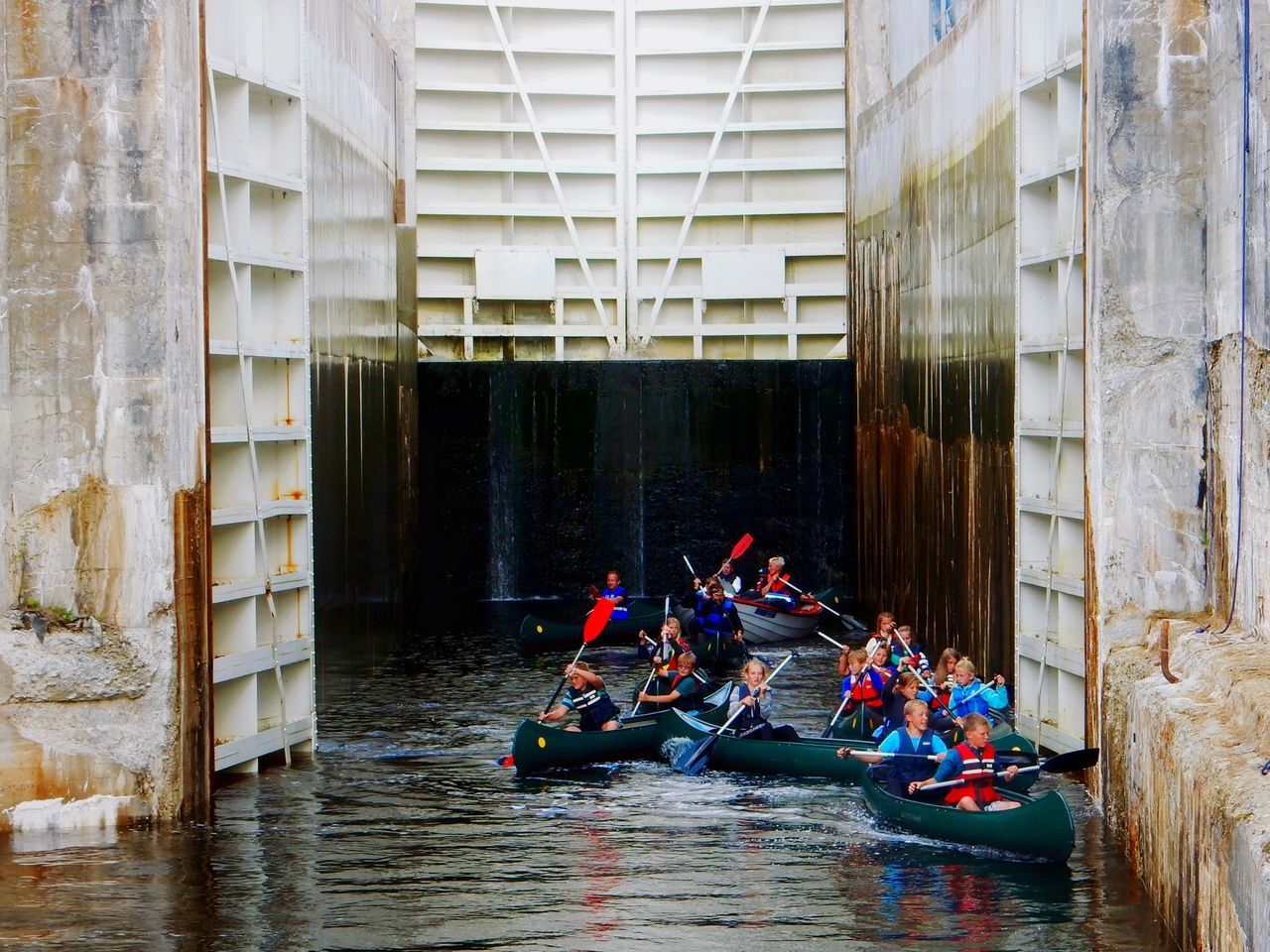 A school class canoeing on a canal and through the river locks River Locks River Canoing Canoe Canoeing Wildlife Wildlife & Nature Active Lifestyle  School Activity Outdoors Adventure Buddies Sport Sports Sports Photography Leisure Activity Activity Outdoor Activity Rowing Canal Boat