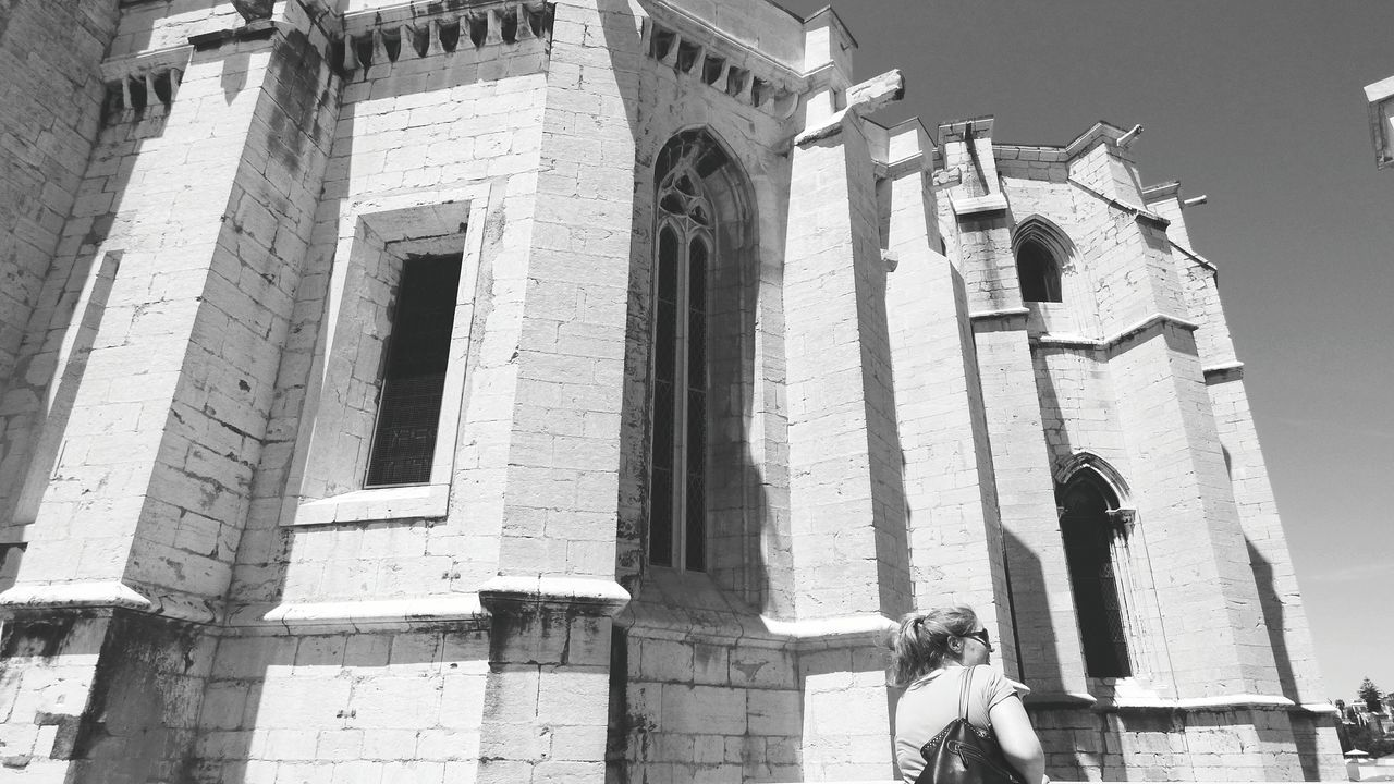 Low Angle View Outdoors One Person One Woman Only Building Exterior Travel Destinations Architecture Built Structure Clear Sky Sunlight Sky Black And White Monochrome Photography Monochrome Rear View The Architect - 2017 EyeEm Awards Live For The Story