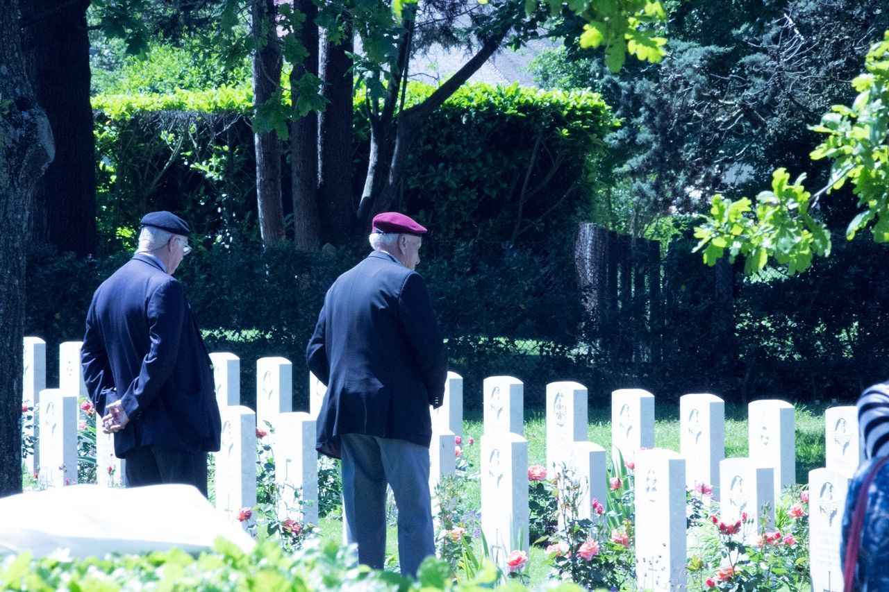 Remembering those that didn't come home Carefree Childhood Day Fence Friends Friendship Front View Hat In A Row Leisure Activity Lifestyles Lost Youth Memorial Military Occupation Real People Remember Standing Togetherness Tree Waist Up Wood World War 2