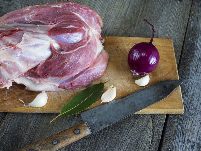 raw pork shank on cutting board on old weathered wooden background Background Close-up Cutting Food Food And Drink Freshness Healthy Eating High Angle View Indoors  Knife Meat No People Old Pork Raw Shank Table Weathered Wooden