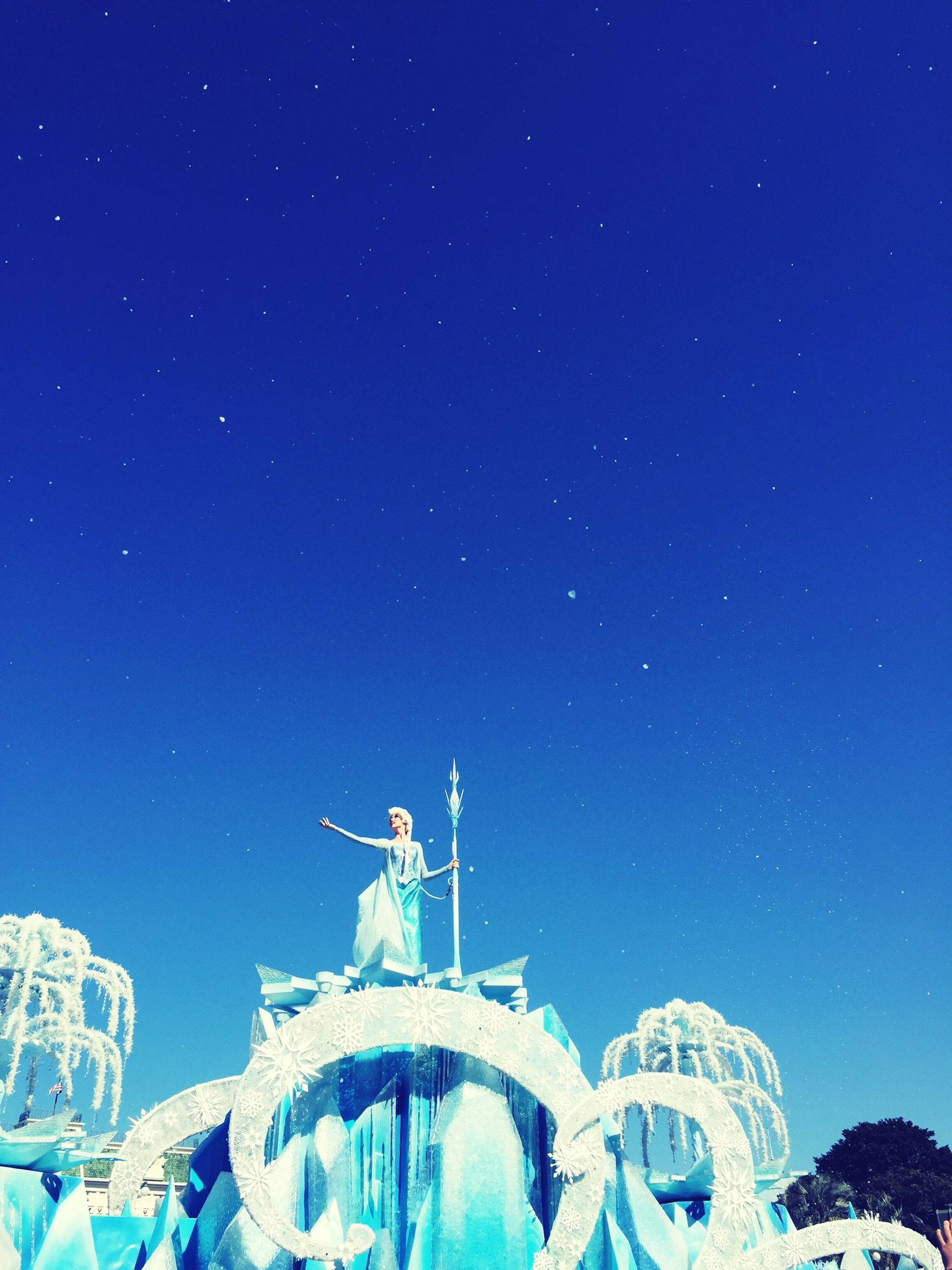 blue, clear sky, copy space, night, low angle view, winter, cold temperature, snow, illuminated, nature, outdoors, sky, no people, built structure, tranquility, beauty in nature, architecture, scenics, tranquil scene, travel
