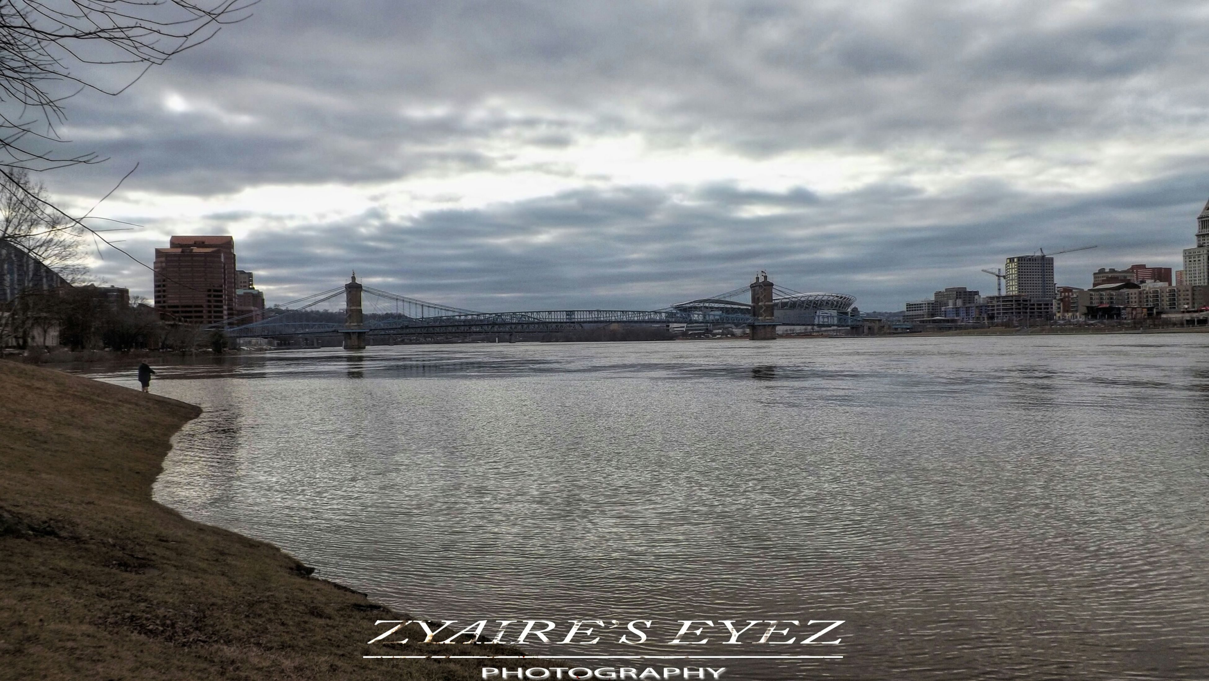 sky, water, building exterior, architecture, built structure, cloud - sky, cloudy, city, sea, river, cloud, waterfront, weather, cityscape, overcast, mid distance, nature, outdoors, day, transportation