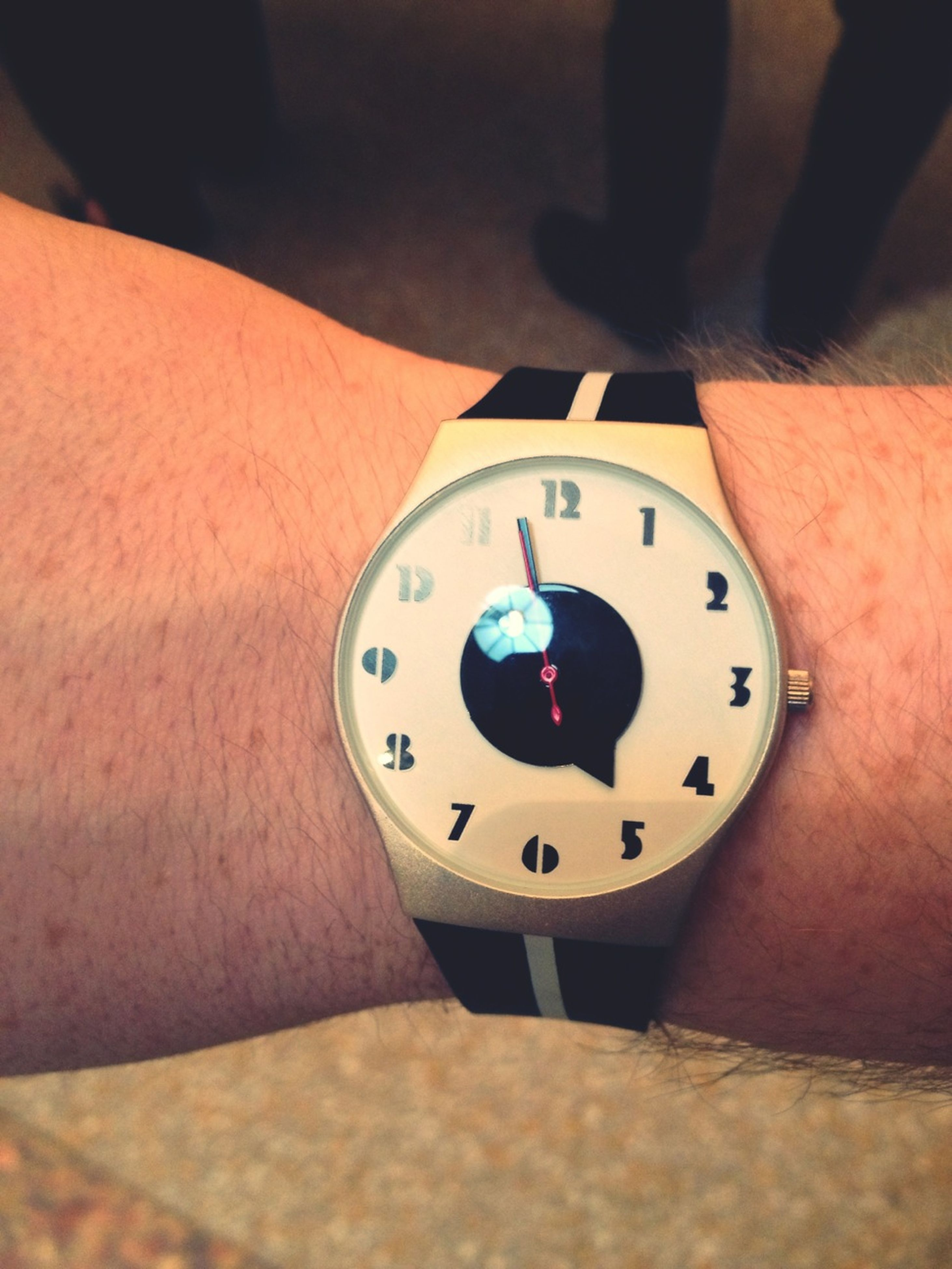 indoors, person, part of, close-up, time, holding, technology, cropped, accuracy, clock, human finger, old-fashioned, single object, number, wristwatch, photography themes, high angle view