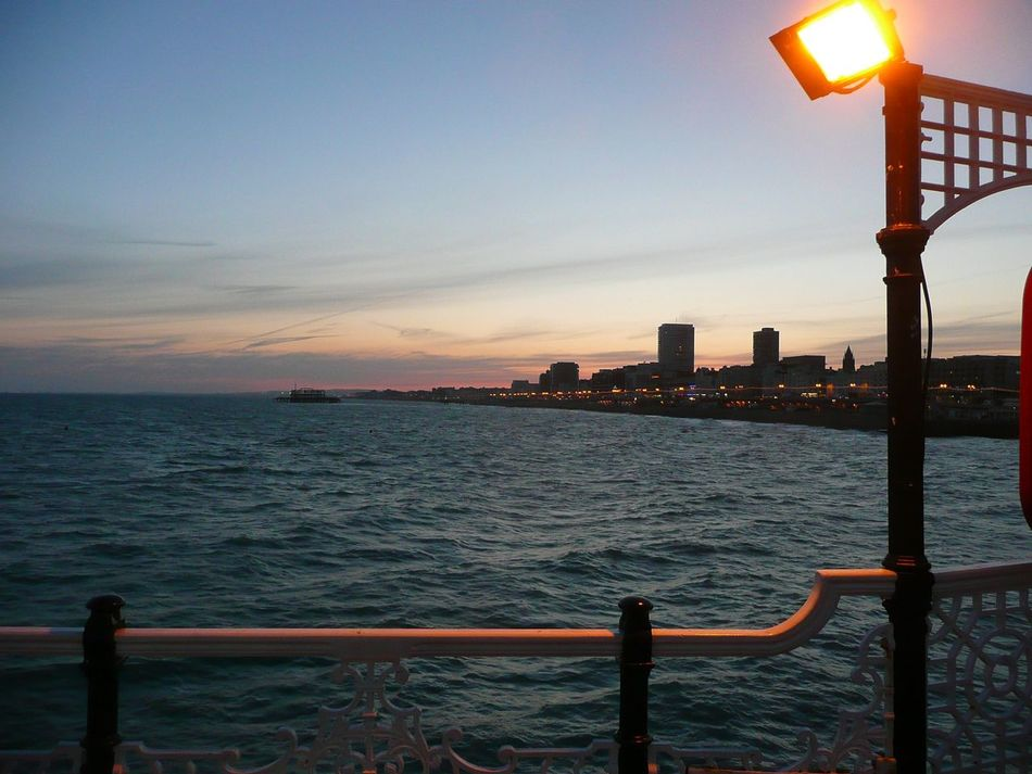 Brighton skyline at sunset seen from Palace Pier Architecture Beauty In Nature Coin-operated Binoculars Day Horizon Over Water Nature No People Outdoors Railing Sea Sky Sunset Water Brighton Brighton Pier Brighton Beach Brighton Uk Brighton Seafront