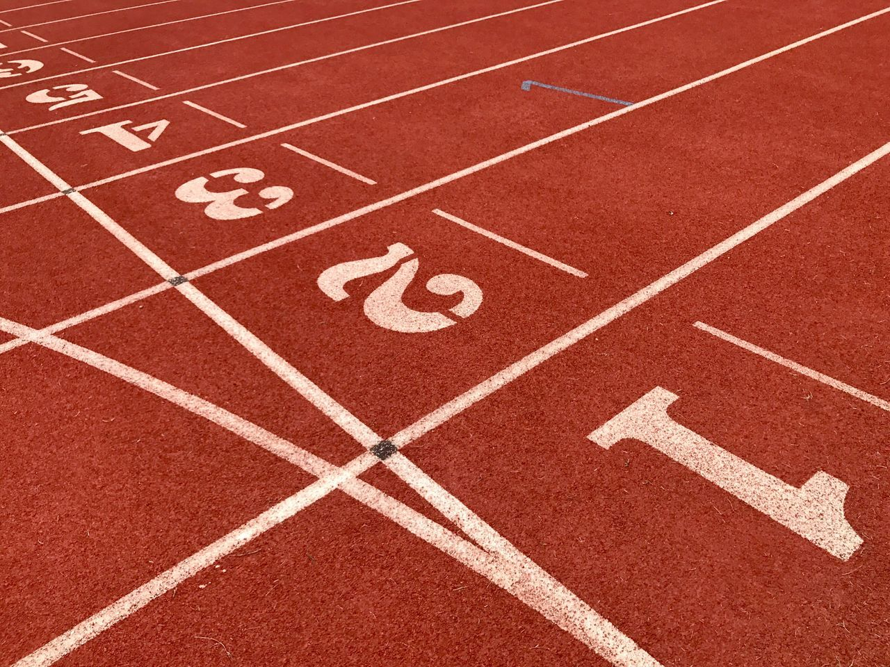 Running Track Sports Track Sports Race Track And Field Sport Competition Number Starting Line Competitive Sport Playing Field Sprinting Sports Venue Track And Field Stadium Healthy Lifestyle Red No People Outdoors Exercising Track Event Stadium