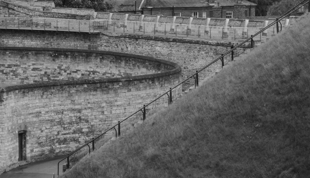 Ancient Black And White Photography Castle Walls, Contemporary Curved  Defence Diagonal Lines Dominance Doorway Empty Encompassed Gateway Grass Intersection Juxtaposed Medieval Oppression Pattern Question Railing Ramparts Redundant SLICE Stone Tourism