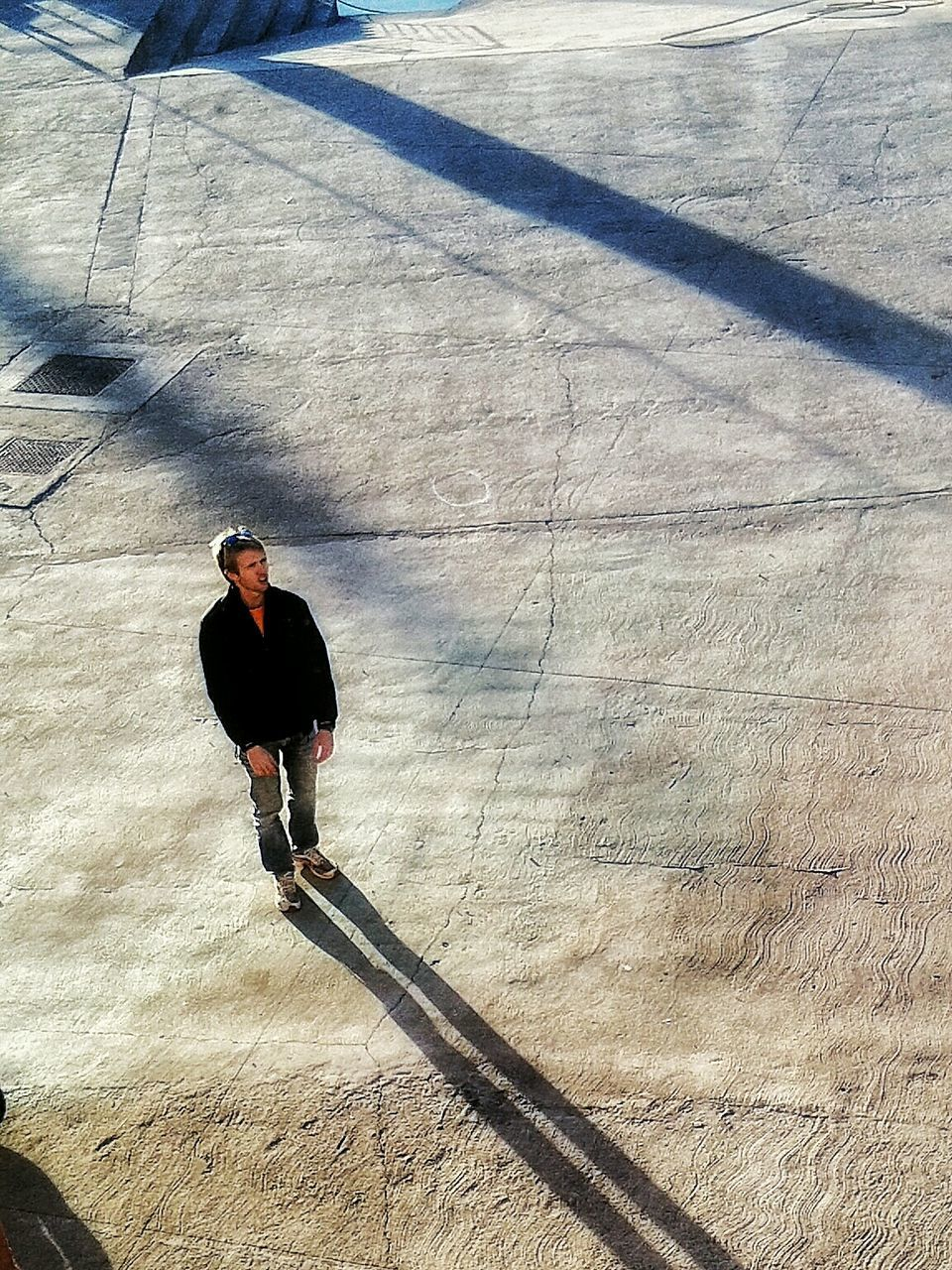 one person, shadow, full length, day, high angle view, leisure activity, sunlight, one man only, lifestyles, outdoors, only men, skill, sport, real people, skateboard park, young adult, adult, men, adults only, sportsman, people