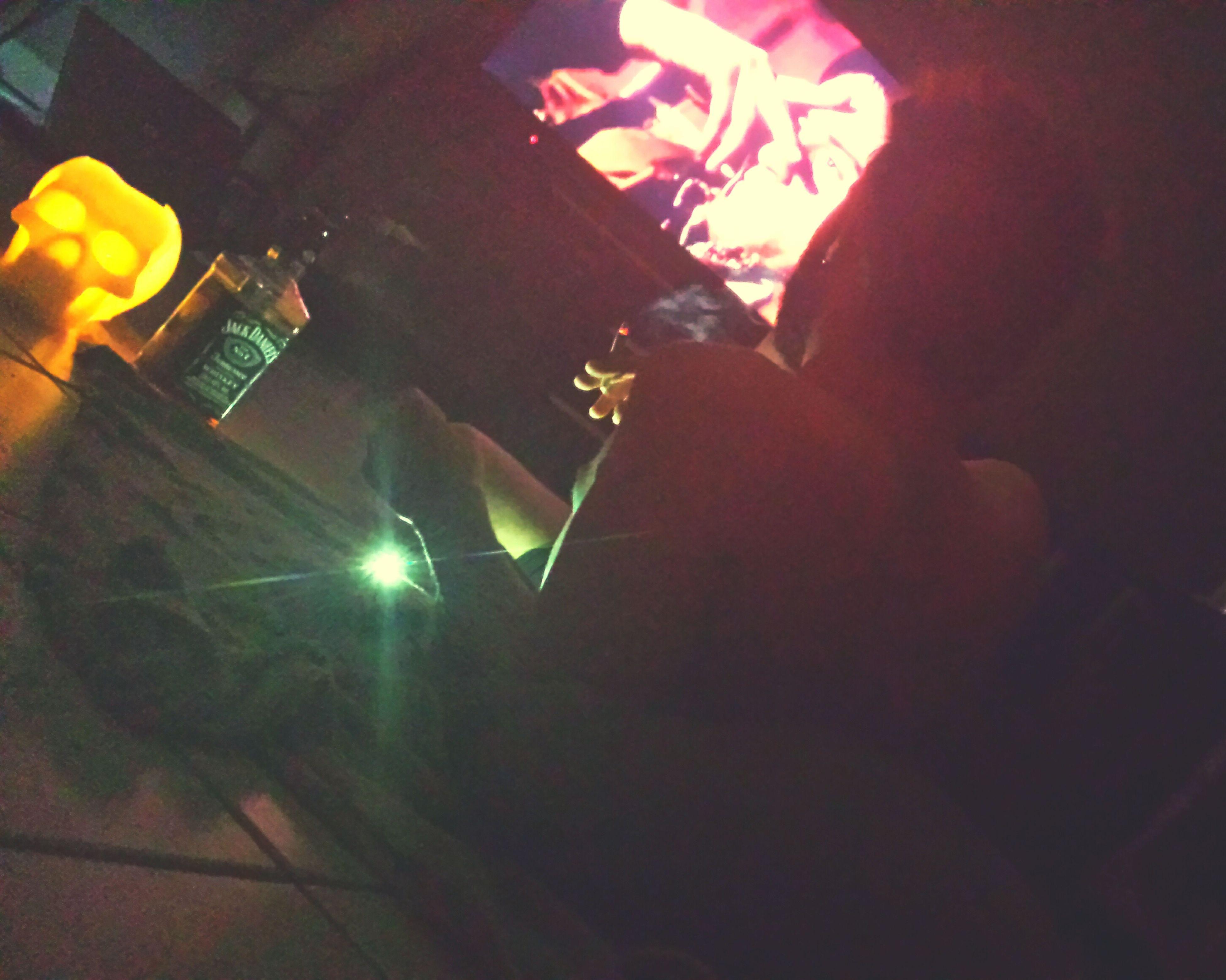 illuminated, indoors, night, lifestyles, lighting equipment, celebration, leisure activity, person, men, light - natural phenomenon, high angle view, unrecognizable person, sunlight, decoration, home interior, built structure, architecture