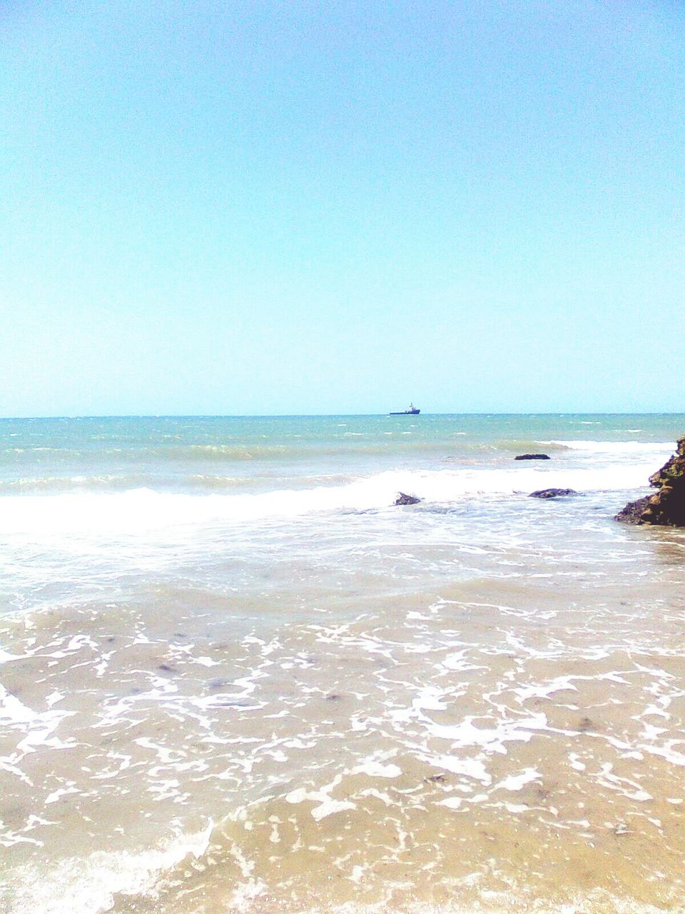 sea, horizon over water, water, beach, scenics, nature, beauty in nature, clear sky, tranquility, copy space, tranquil scene, outdoors, sky, day, wave, sand, travel destinations, vacations, blue, no people